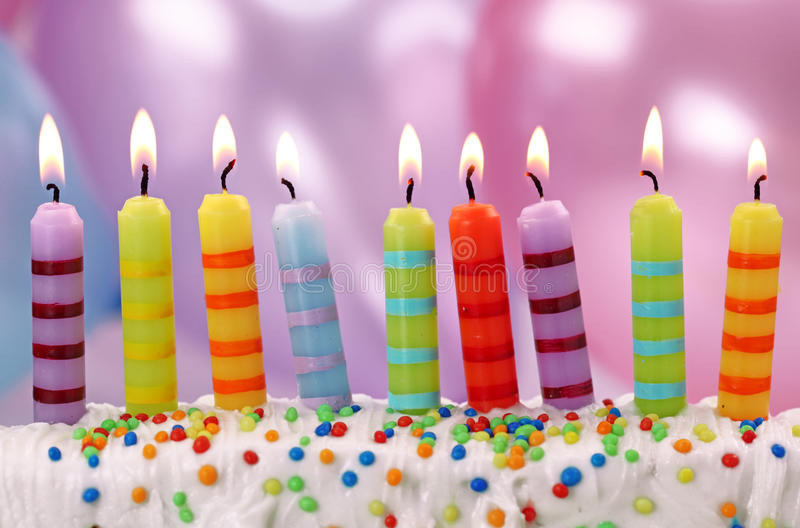 Nine birthday candles. On lilac background royalty free stock images