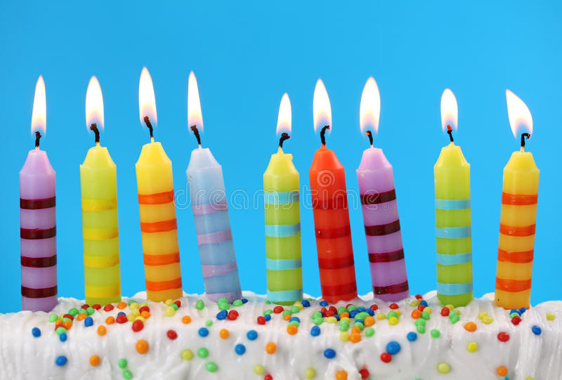 Nine birthday candles. On blue background royalty free stock photography