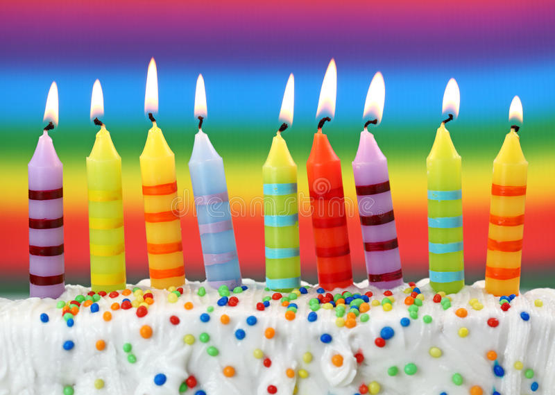 Nine birthday candles. On colorful background stock photography