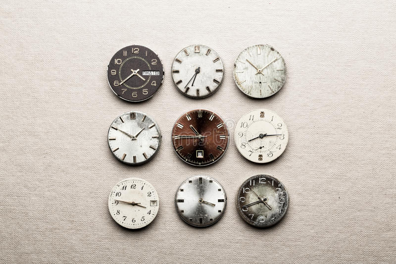 Nine clock dials. Showing different time stock photos