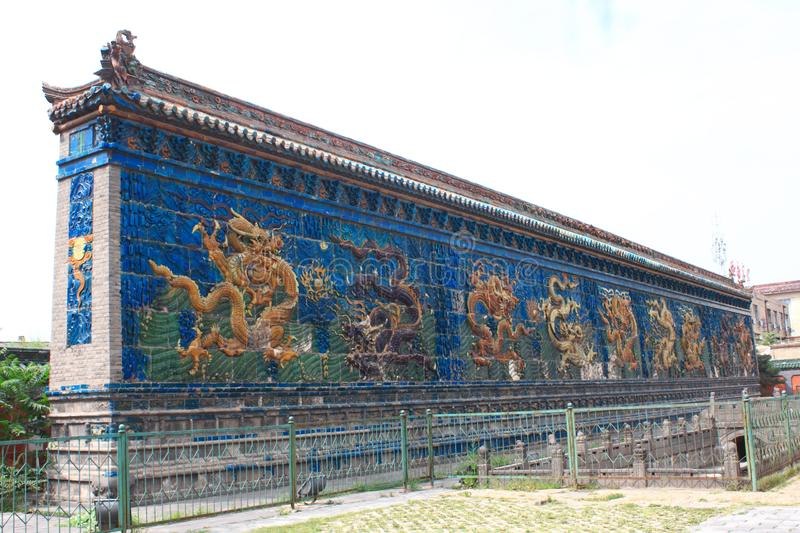 Nine dragon screen. Is also called nine dragon wall.Until recently, there were altogether three s in China. This is Datong Nine-dragon screen. And it`s the royalty free stock photography