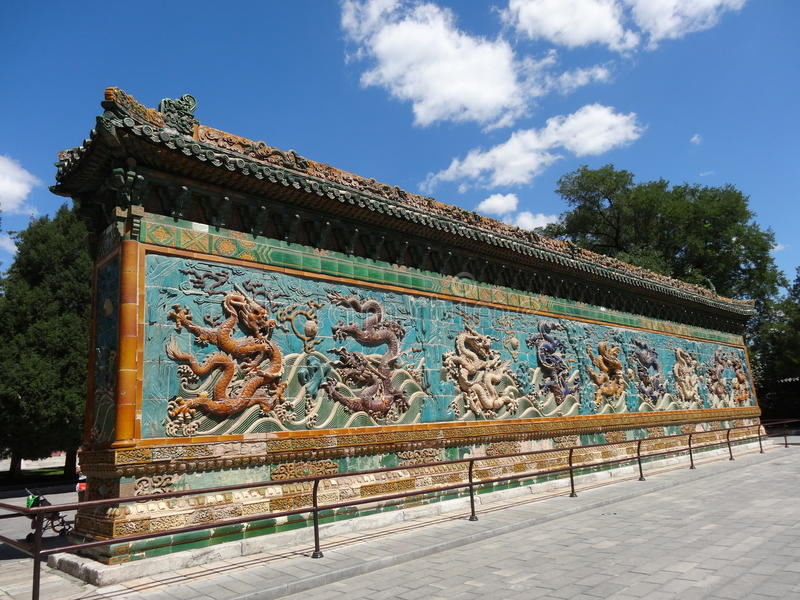 The Nine Dragon Wall. It was a screen wall with reliefs of nine different Chinese dragons. Such walls are typically found in imperial Chinese palaces and gardens royalty free stock photo