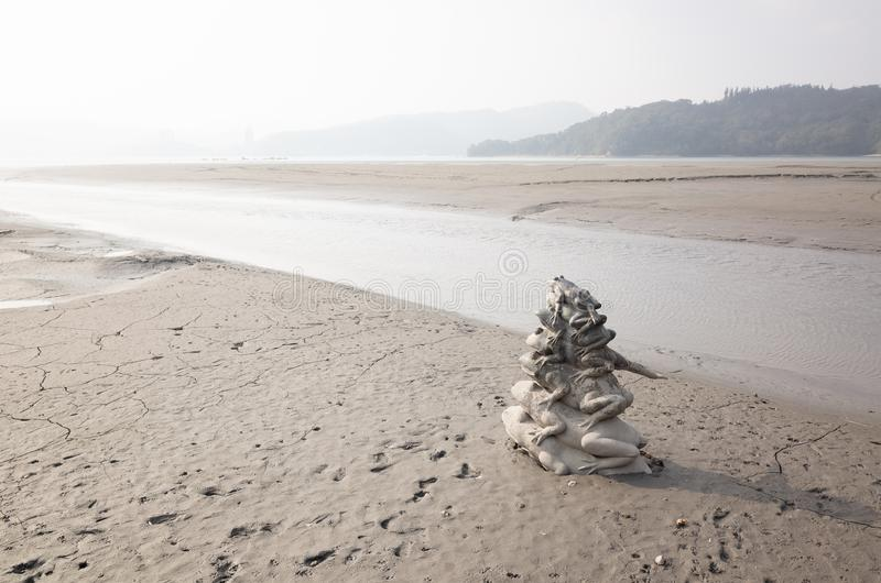 Nine Frog Statue stacks in Sun Moon Lake stock photos