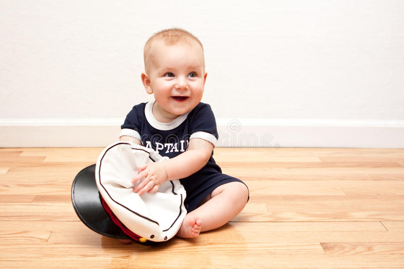 Nine month old baby in navy blue and white stock photography