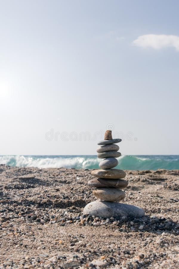 Nine pieces of stone in balance at the agitated seaside. In summer stock photo