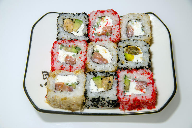 Nine sushi on a white plate stock photo