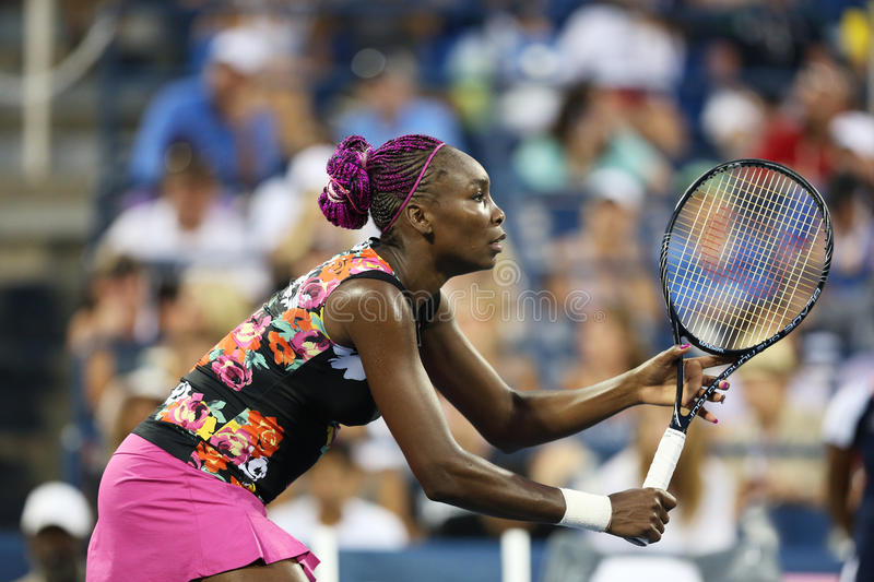 Nine times Grand Slam champion Venus Williams during her first round doubles match with teammate Serena Williams at US Open 2013 库存图片