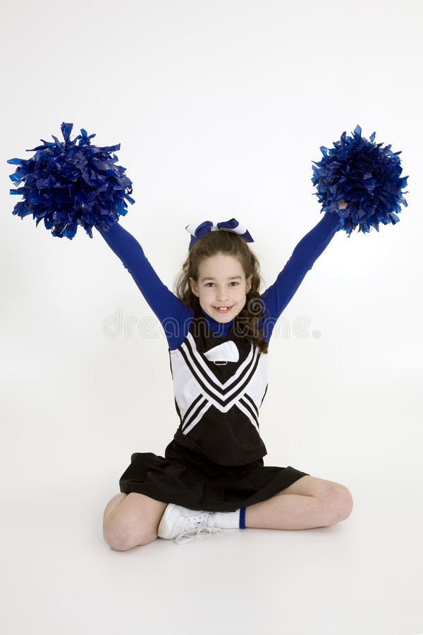 Free Nine Year Old Caucasian Girl Dressed In A Blue Cheerleader Outfit Royalty Free Stock Images - 1974669