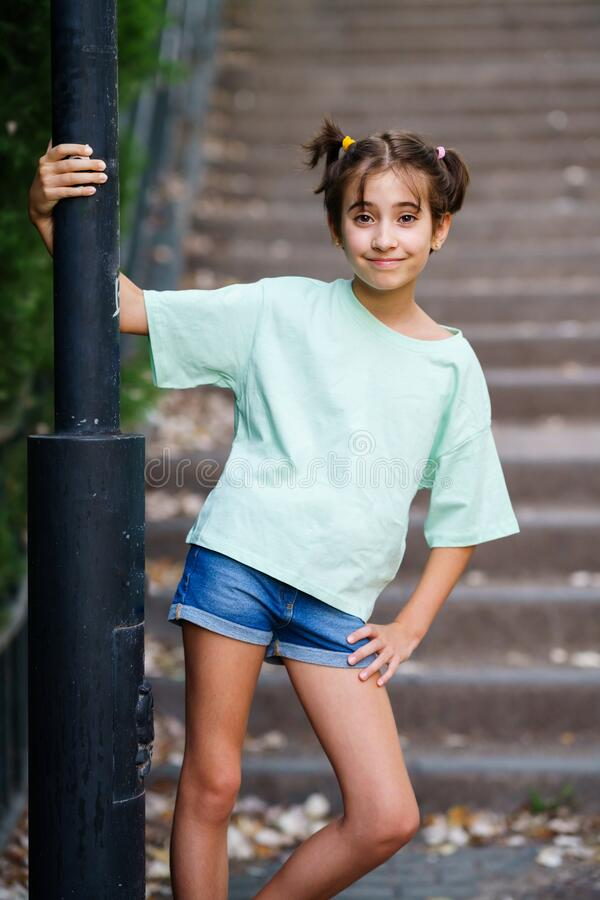 Free Nine-year-old Girl Standing On The Steps Outdoors Stock Photography - 191753292