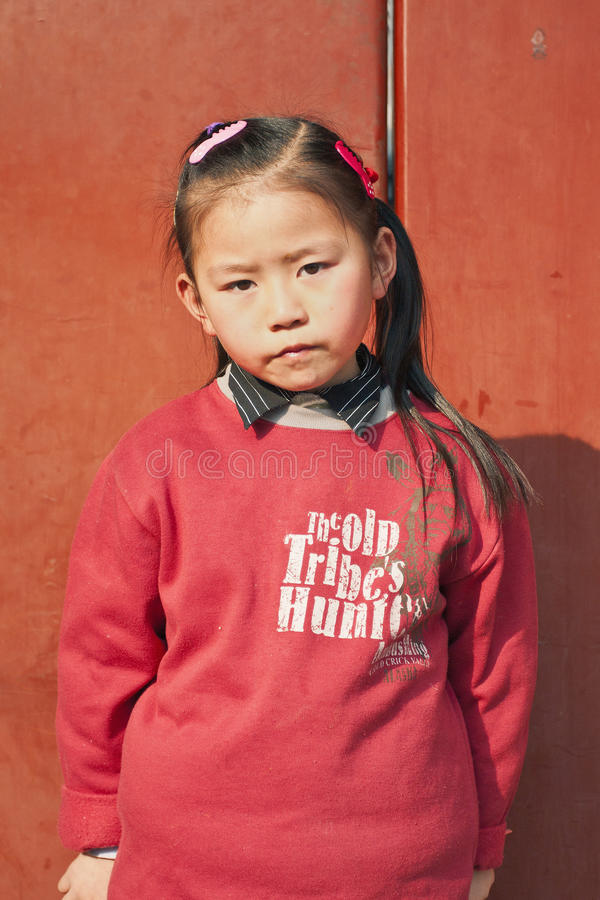 Nine years old cute Chinese girl in front of her home, Beijing, China royalty free stock photography