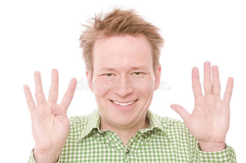 Nine. Young happy smiling man showing the number nine on his fingers - isolated on white and retouched (As this is part of a series going from 1 to 10, you can royalty free stock images