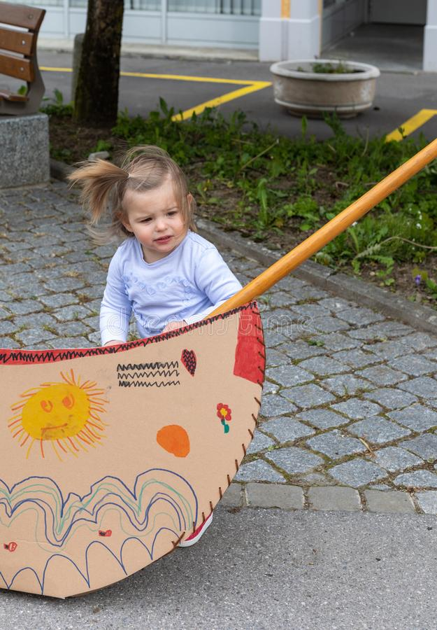 Baby Girl. Playing. Boat. Cardboard. Toys stock photography
