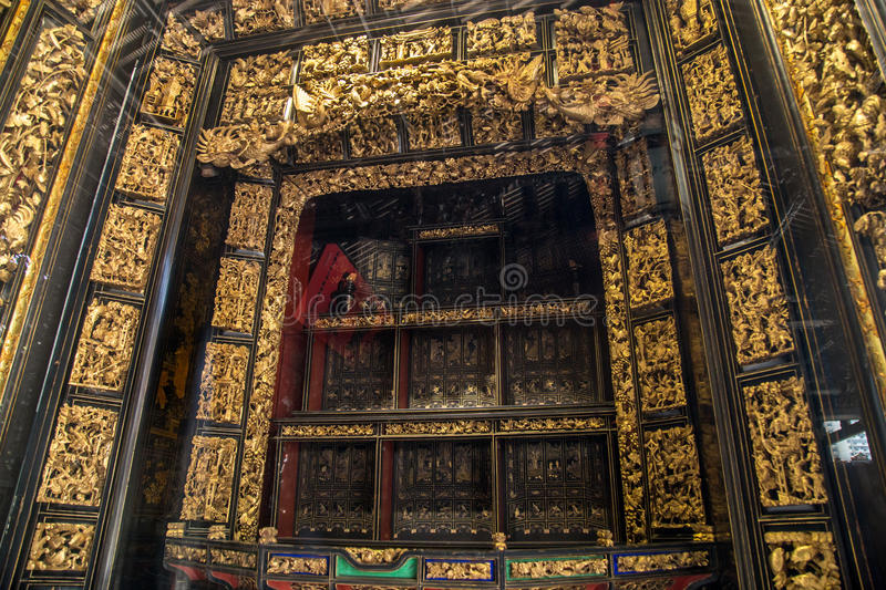 In nineteenth Century, Chaozhou used precious wood carvings of art to worship ancestors and mythological figures. Chen Jia CI Tang and Chen Academy said. Built stock photos