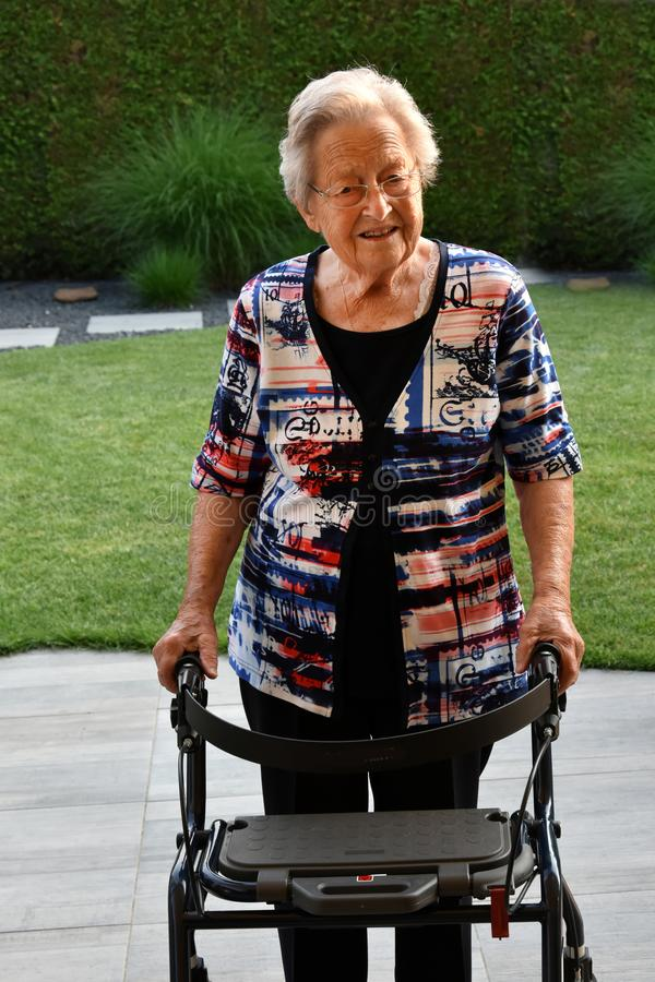 Senior woman with walking aid royalty free stock photography