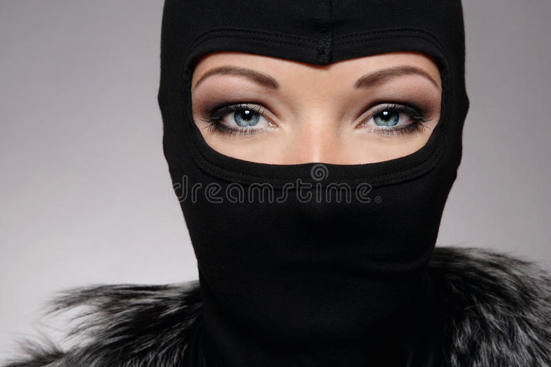 Ninja. Head of woman with beautiful eyes in black mask royalty free stock photo