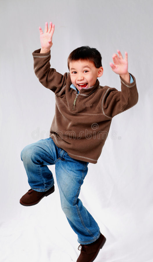 Ninja. Cute asian boy jumping in the air stock images