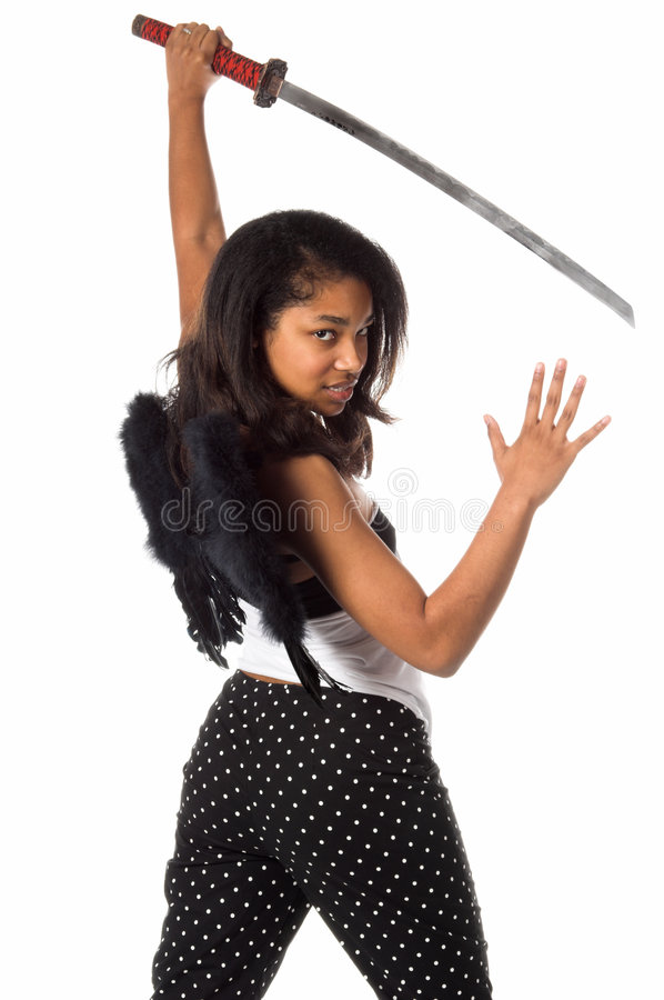 Ninja Angel. African American woman as a Ninja Angel with black feather wings and an intense expression ready to attack with a Samurai Sword royalty free stock images