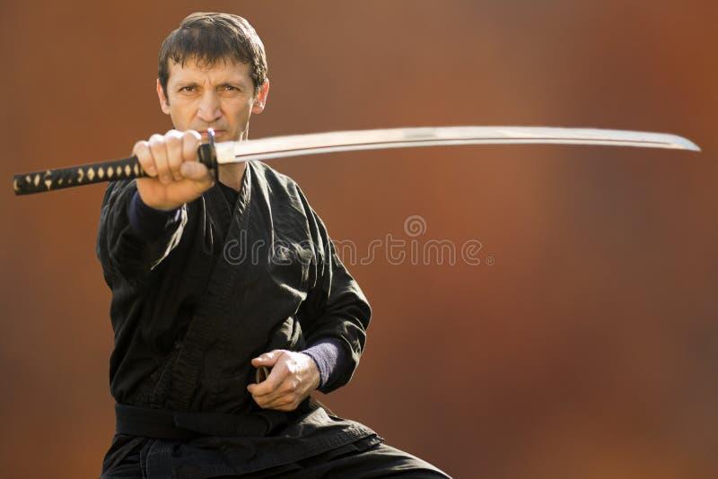 Ninja con la spada fotografia stock