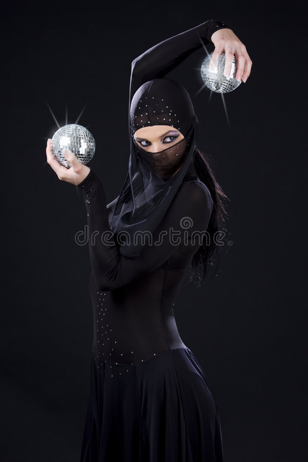 Ninja dance. Party dancer in ninja dress with disco balls royalty free stock image
