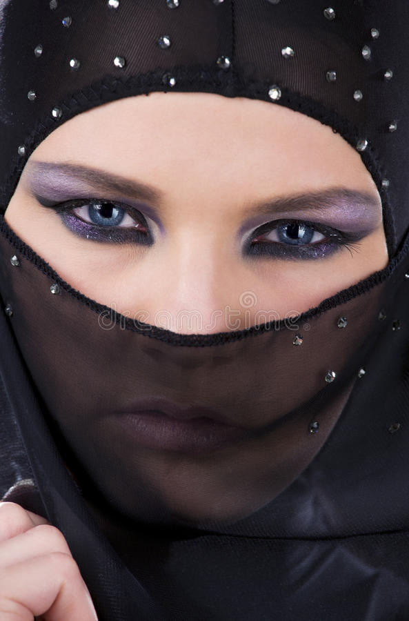 Ninja face. Closeup picture of ninja face in the dark stock image