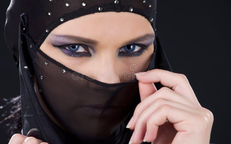 Ninja face. Closeup picture of ninja face in the dark royalty free stock photo