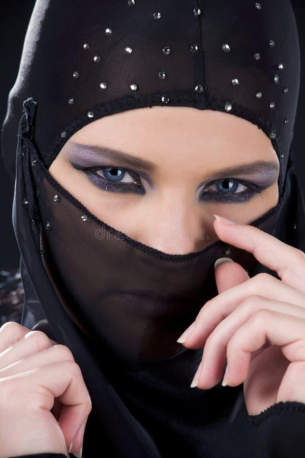Ninja face. Closeup picture of ninja face in the dark royalty free stock photos