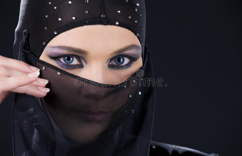 Ninja face. Closeup picture of ninja face in the dark royalty free stock image