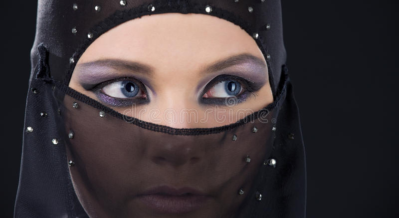 Ninja face. Closeup picture of ninja face in the dark stock photo