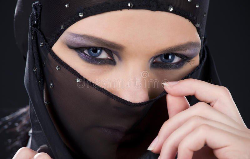 Ninja face. Closeup picture of ninja face in the dark royalty free stock images
