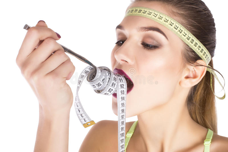 Ninja Portrait eating measure tape diet concept royalty free stock photos