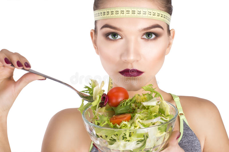 Ninja Portrait eating vegetables diet concept. Ninja Portrait of woman eating vegetables diet concept royalty free stock photo