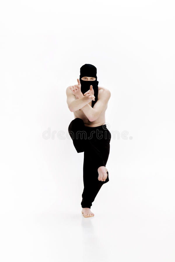 Ninja on white background. Male fighter in black clothes. Ninja on a white background. Male fighter in black clothes royalty free stock photography