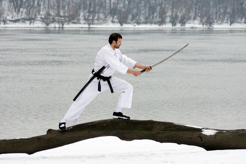 Martial arts with sword at winter stock image
