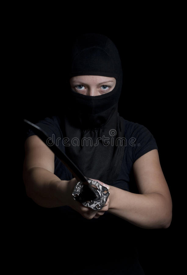 Ninja woman. Blue eyes woman pretended to be ninja stock image
