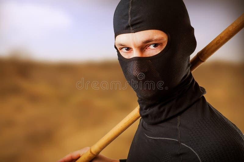 Ninja in zwart masker stock foto's