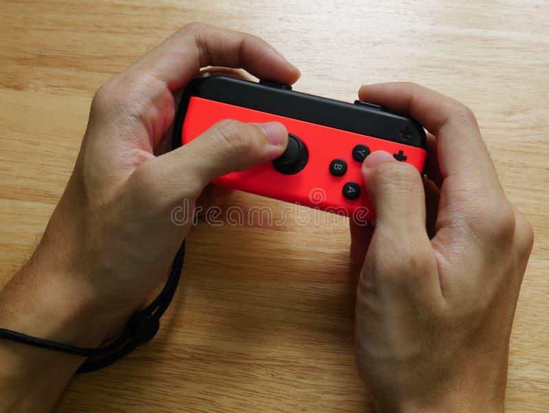 Nintendo Switch controller held in hands. stock photo
