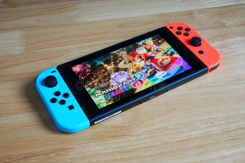 Nintendo Switch showing its screen with Mario Kart 8 Deluxe game. royalty free stock images