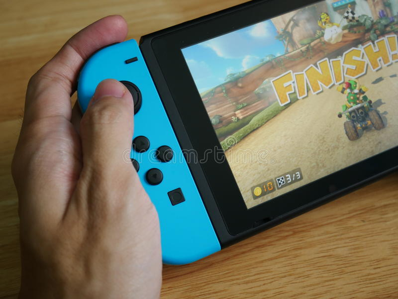 Nintendo Switch, the video game console held in hand. stock images