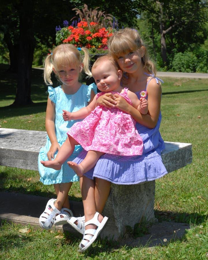 nio systrar royaltyfri foto