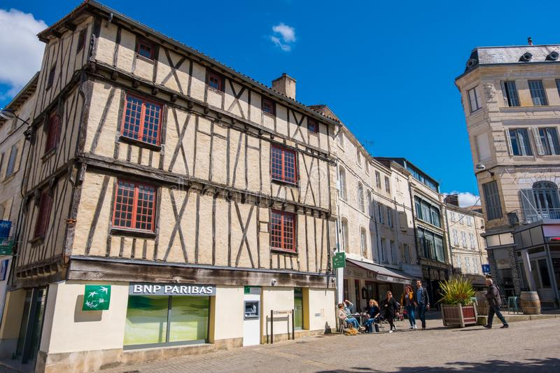 Half-timbered house and cafe terrace of the old town of Niort, Deux-Sevres, France. Niort, France - May 11, 2019: Half-timbered house and cafe terrace of the old royalty free stock photo