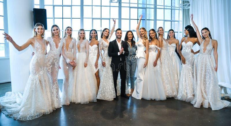 Nir Moscovich, Berta Balilti and models posing backstage before the Berta Bridal Spring 2020 fashion show. NEW YORK, NY - APRIL 12: Nir Moscovich, Berta Balilti stock images