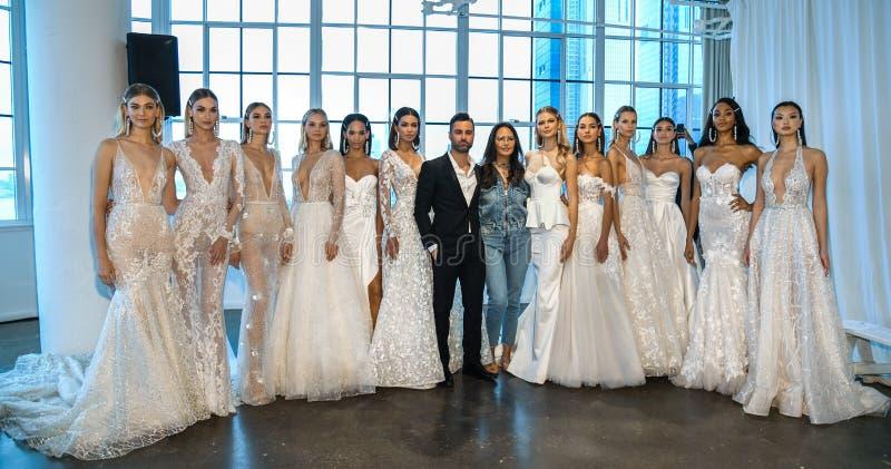 Nir Moscovich, Berta Balilti and models posing backstage before the Berta Bridal Spring 2020 fashion show. NEW YORK, NY - APRIL 12: Nir Moscovich, Berta Balilti royalty free stock photos