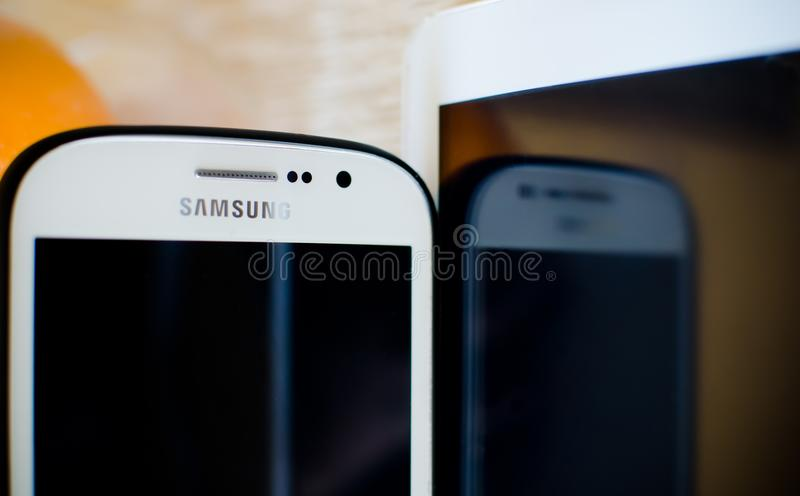 Samsung mobile phone with white tablet. Nis, Serbia, March 3, 2018: Samsung mobile phone with white tablet and reflection, modern view royalty free stock image