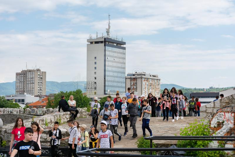 Large group of young people on a sightseeing tour visiting old medieval fortress in the city of Nis, Serbia, Europe. Nis, Serbia - May 25, 2019: Large group of royalty free stock photos