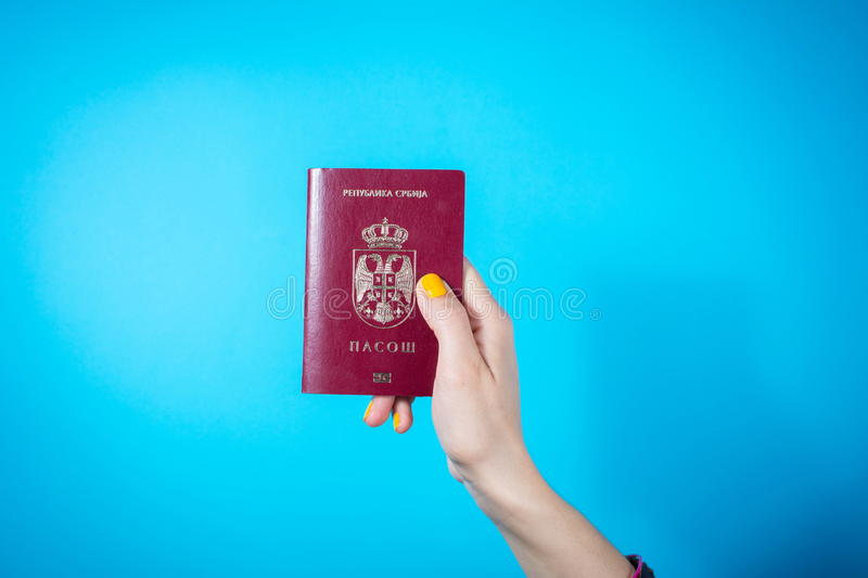 NIS, SERBIA - MAY 18, 2016: Woman hand holding Serbian passport royalty free stock photography
