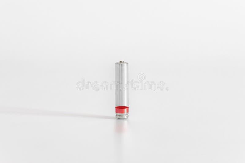 Niska bateria na białym tle Minimalny pojęcie obraz royalty free