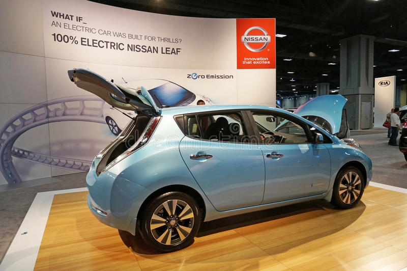 Nissan Leaf Electric Vehicle. Photo of 2015 light blue nissan leaf electric vehicle at the washington dc auto show on 1/24/15 at the dc convention center. This stock image