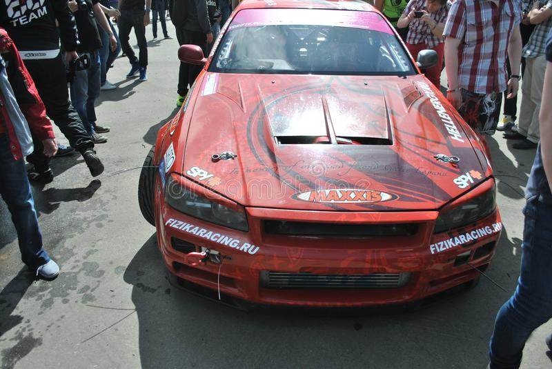 Nissan Skyline r34. championship races, Sportscar tuning Competitions on tuned cars in drift rds royalty free stock images