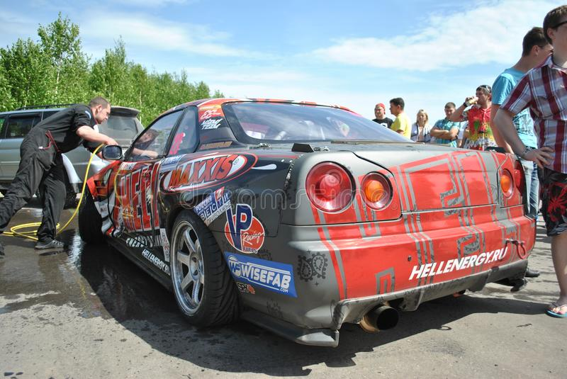Nissan skyline r34 tuning Competitions on tuned cars in drift rds royalty free stock image