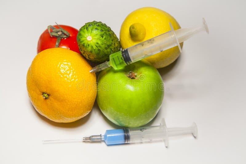 Nitrate syringe fruit vegetable white background stock photos